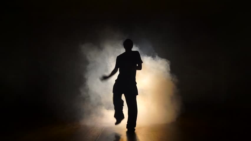 Dancer in the smoke in the dark.   Shutterstock HD Video #21777733