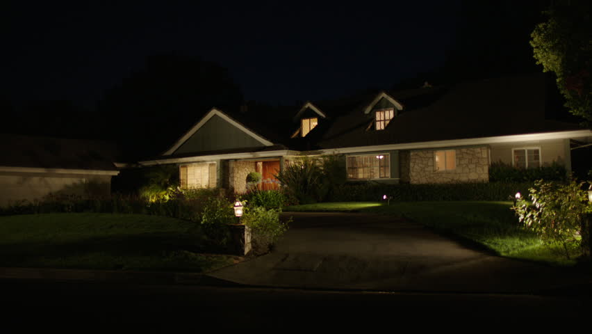 night Static one story house 2 dormer windows that can play two story house Nice landscaping accent lighting, circular driveway, all lights