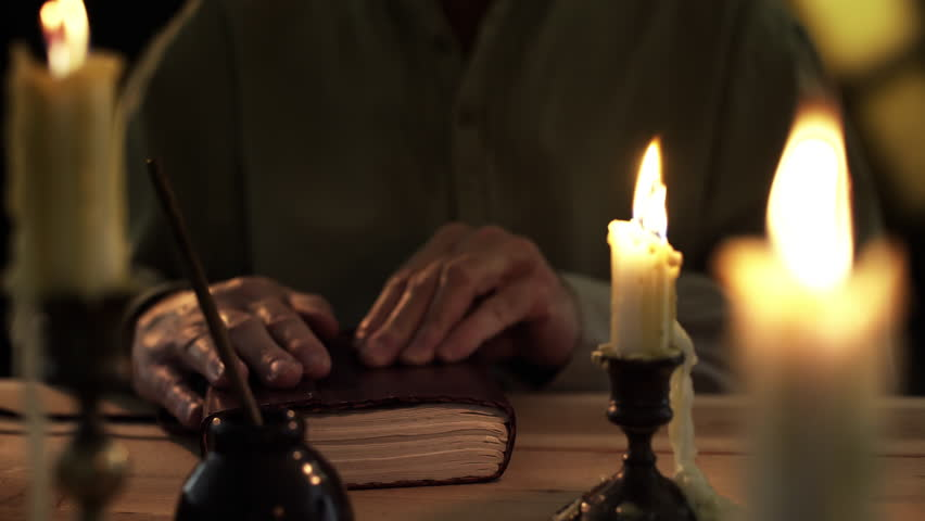 Flickering candlelight and a dip pen set the mood in this period piece of an early American man recording his thoughts in a diary.