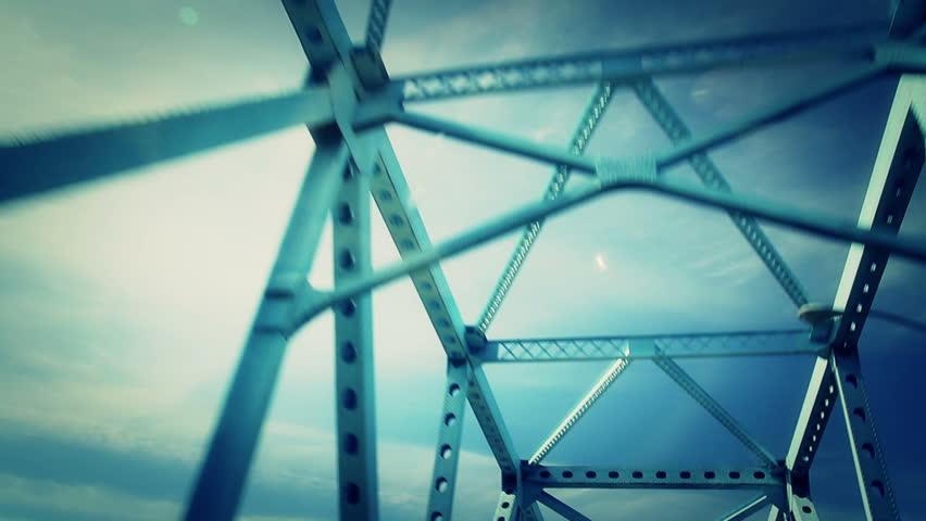 Driving over a steel bridge.  Looking up perspective.