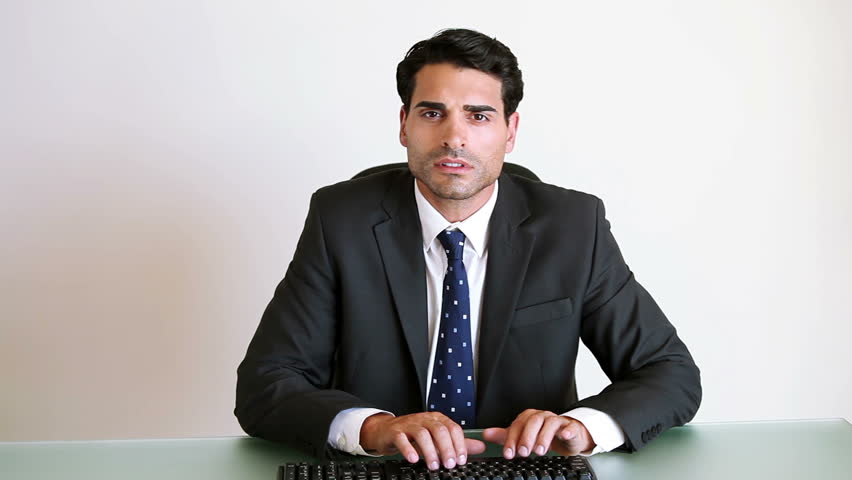 Business Man Speaking On Cellphone Stock Image - Image: 27015381