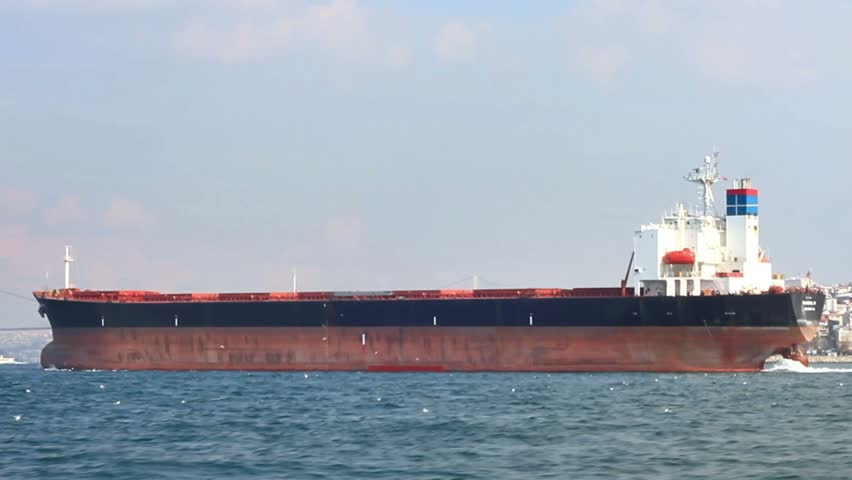 Tanker ship sails in the sea. Side view of the oil tanker.