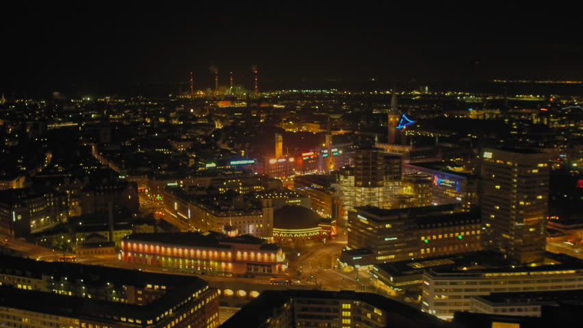 WS AERIAL Drone shots of city at night /...