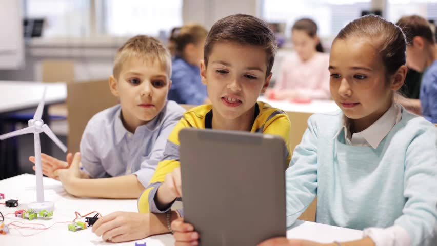 Education, science, technology, children and people concept - group of smiling kids or students with tablet pc computer programming electric windmill toy at robotics school lesson | Shutterstock HD Video #22387822