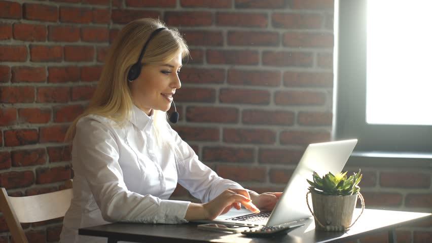 Closeup of a beautiful blonde business customer service woman | Shutterstock HD Video #22448449