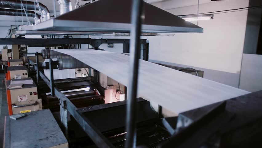 Paper in the process of a printing machine work. Printing establishment detail on production line with sound. | Shutterstock HD Video #22477342