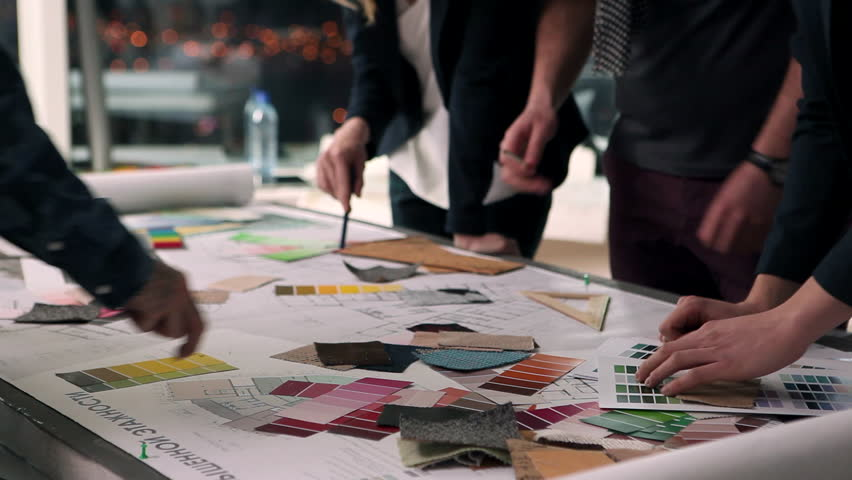 A group of young designers led by the head are working on the project of design business center, private home, studio, shop, office/Designers at Work   Shutterstock HD Video #22496833