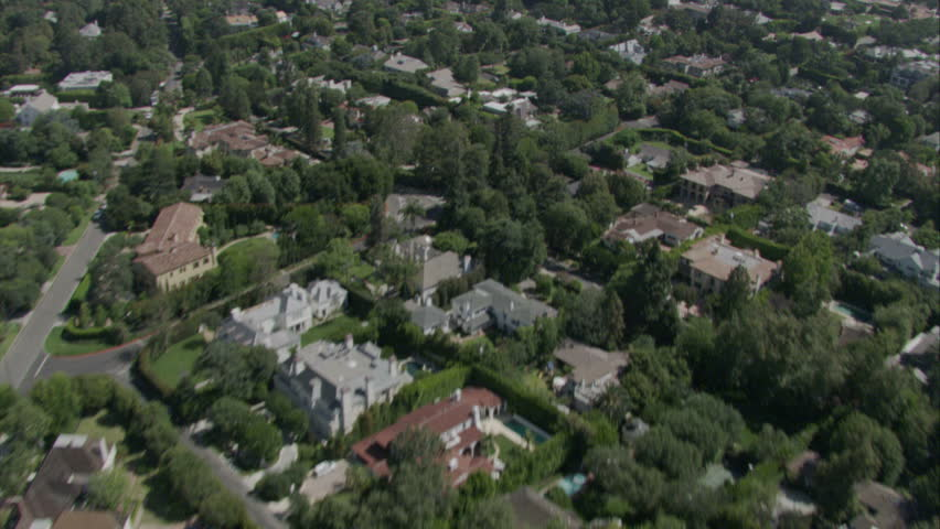 aerial flying shot over luxurious suburban area, streets, and golf course circa 2009
