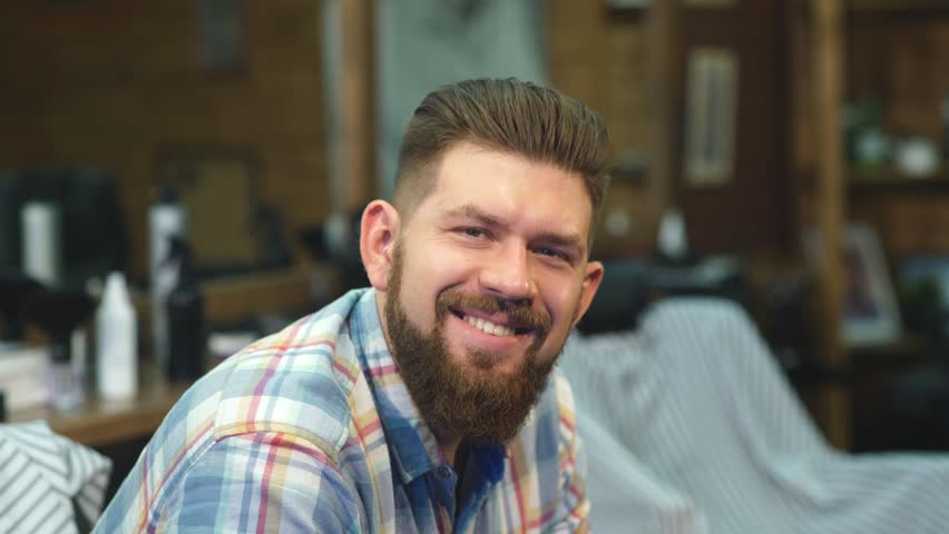 Happy man smiling in a Barber shop | Shutterstock HD Video #22574536