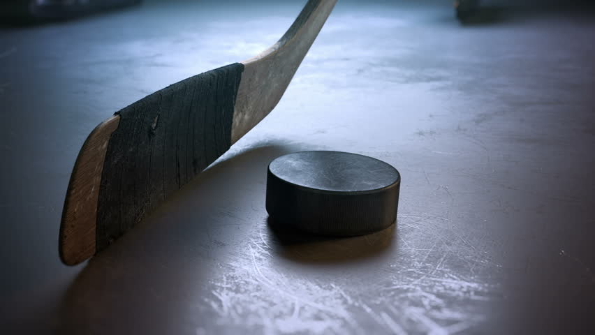 Close-up hockey stick hitting hockey puck in slow motion   Shutterstock Video #22580857