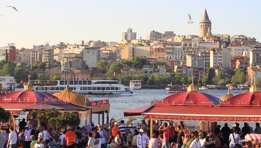ISTANBUL - JUNE 21: Eminonu Pier looking to Goldenhorn and Galata Tower on June