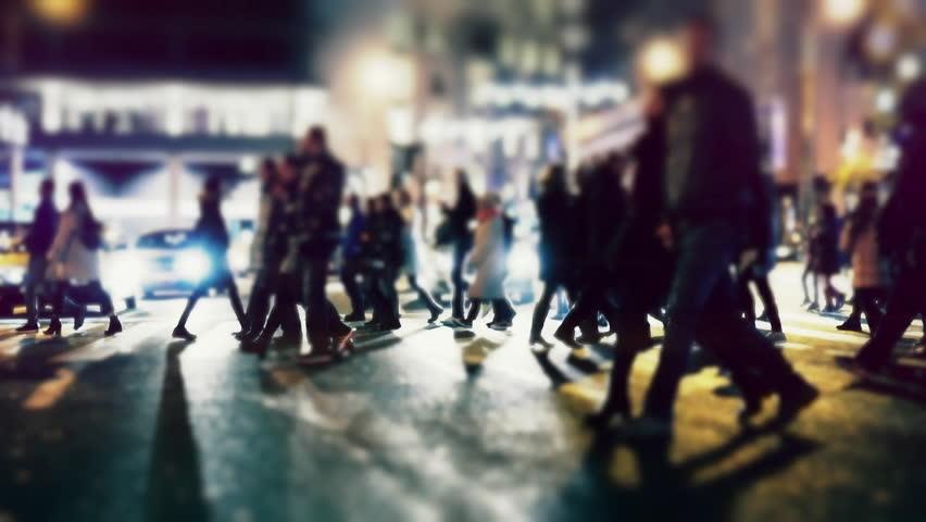 City pedestrians on winter night, cross street,...