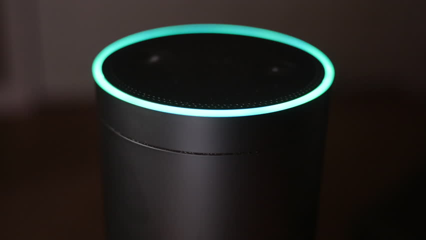 ALIQUIPPA, PA - Circa December, 2016 - An unidentified man at home asks his Amazon Echo how many feet are in a mile.