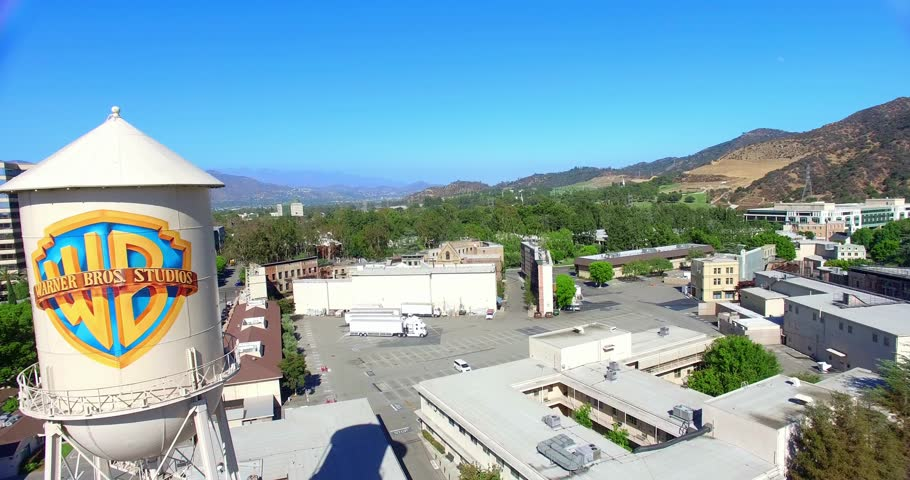 LOS ANGELES, CALIFORNIA, USA - JULY 29, 2015: Aerial view of Warner Brothers Movie Studios and Water Tower in Burbank on July 29, 2015 in Los Angeles, California, 4K