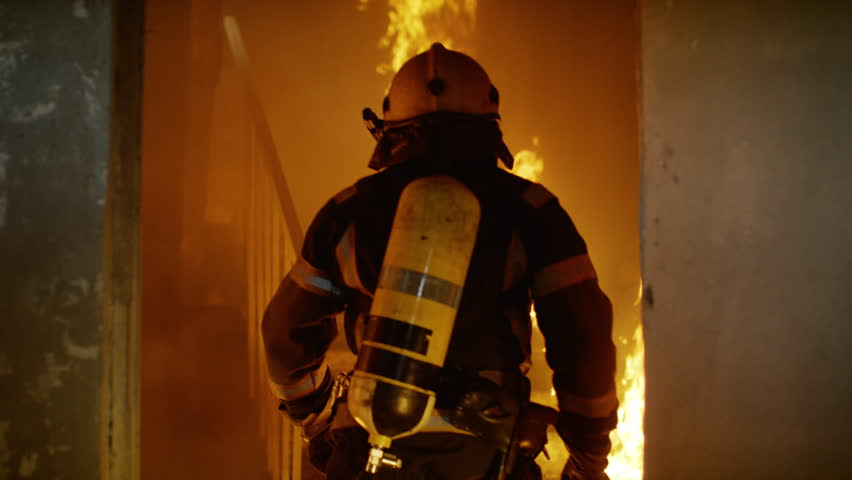 Two Brave Firefighters Go Up Burning Stairs. They Go Through Open Doors. Building is on Fire. Open Flames and Smoke Everywhere. Slow Motion.  Shot on RED EPIC 4K (UHD). | Shutterstock Video #22783501