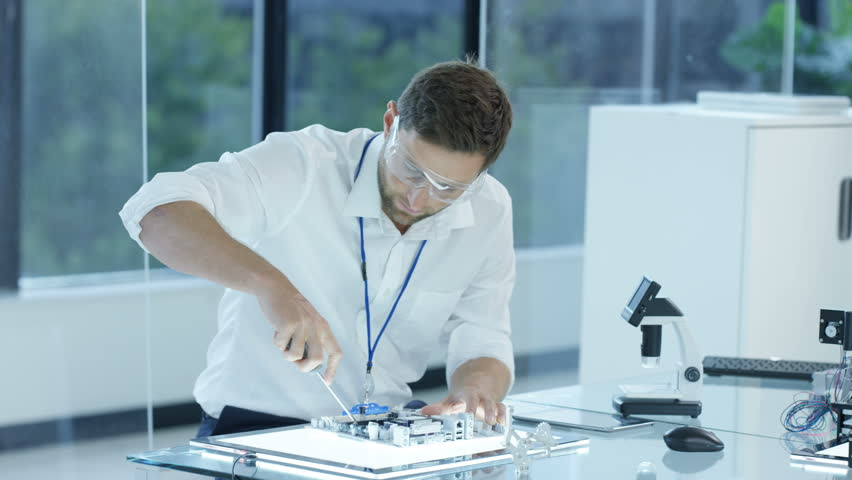 4K Electronic Engineer Working In The Lab Testing 3D Printer Circuit Boards Dec 2016