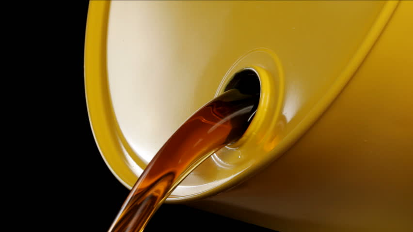 Oil pours out of yellow drum