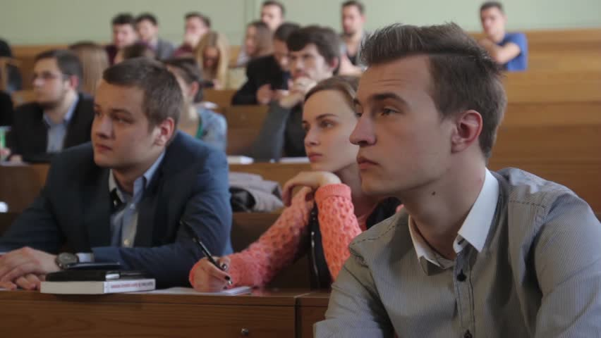 KYIV, UKRAINE - MARCH 20, 2015. Students listen to a lecture while sitting in the audience of the University | Shutterstock HD Video #23058340