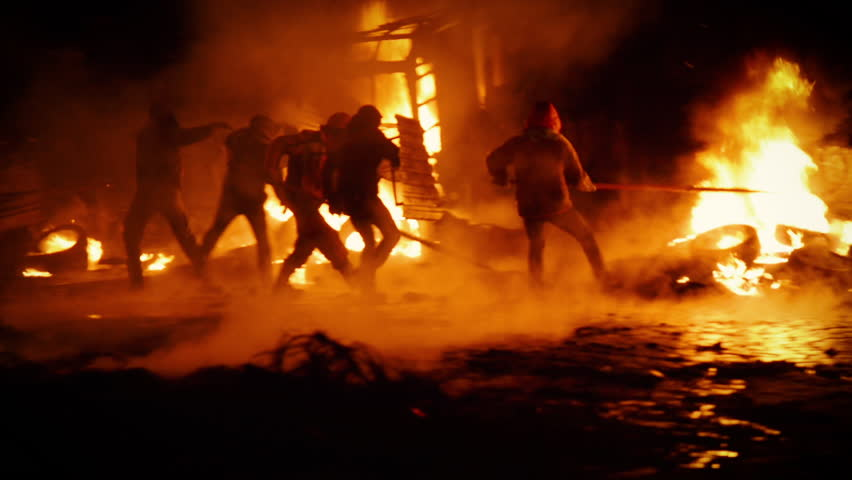 Kiev, Ukraine, January 2014: Protesters throw tires to the fire, exploding stun grenades. During the protests against President Yanukovych in Kyiv on the street Grushevskogo January 19, 2014