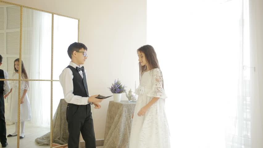 Boy in suit dancing break dance in front of a girl | Shutterstock HD Video #23086417