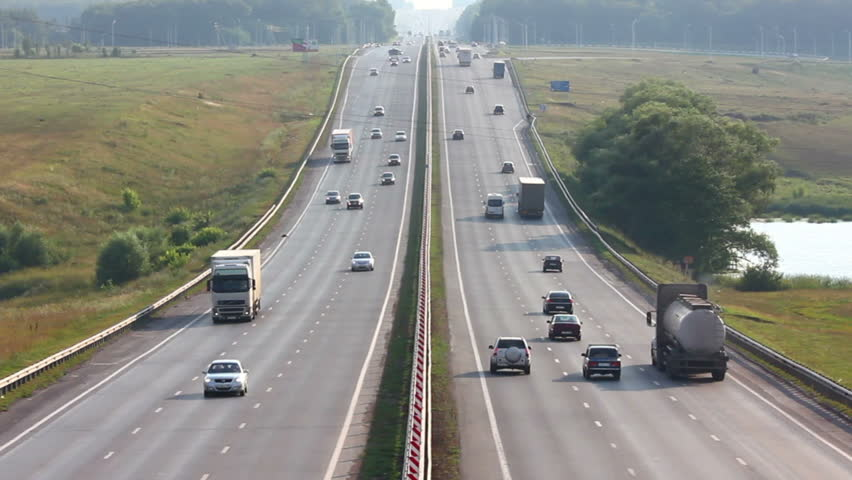cars traveling on highway