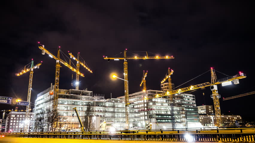 Construction site at night Time Lapse. Working tower cranes, buildings and traffic | Shutterstock HD Video #23419333