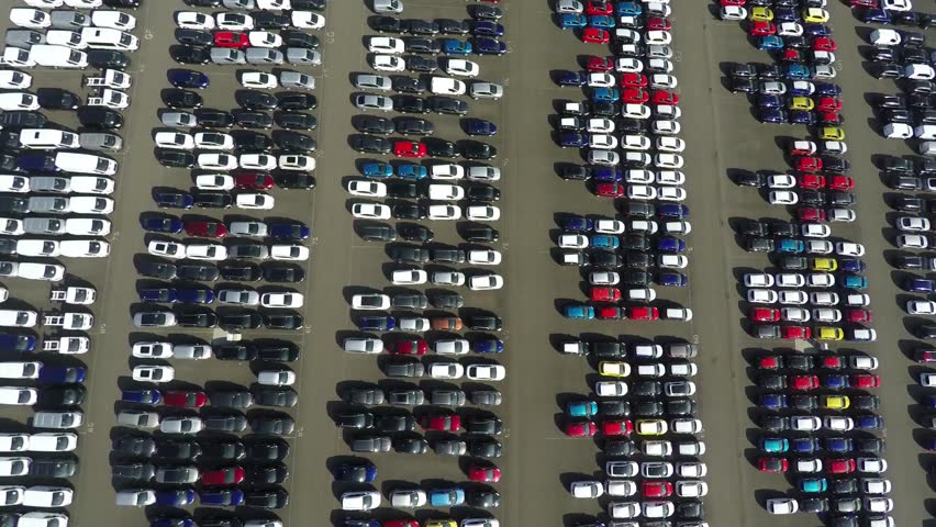 Aerial top down bird view new car storage parking lot showing imported new vehicles or ready to export new automobiles storage facility car industry for American and European market for car sales 4k | Shutterstock HD Video #23469865