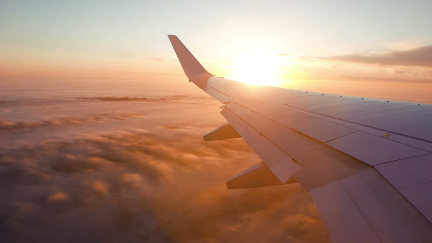 Aerial view of sunrise through airliner window
