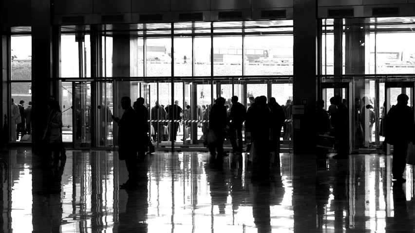silhouette people in enter hall ...