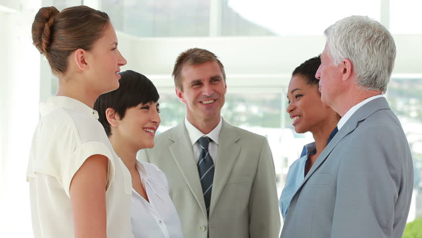 Business people joining hands together in a bright office | Shutterstock HD Video #2361029