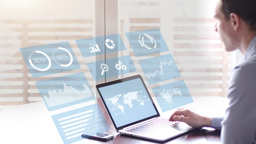 Person using a hologram virtual reality (VR) interface screen with financial data and key performance indicators (KPI) for business intelligence (BI) and with secured access, concept of futuristic HUD   Shutterstock HD Video #23694271