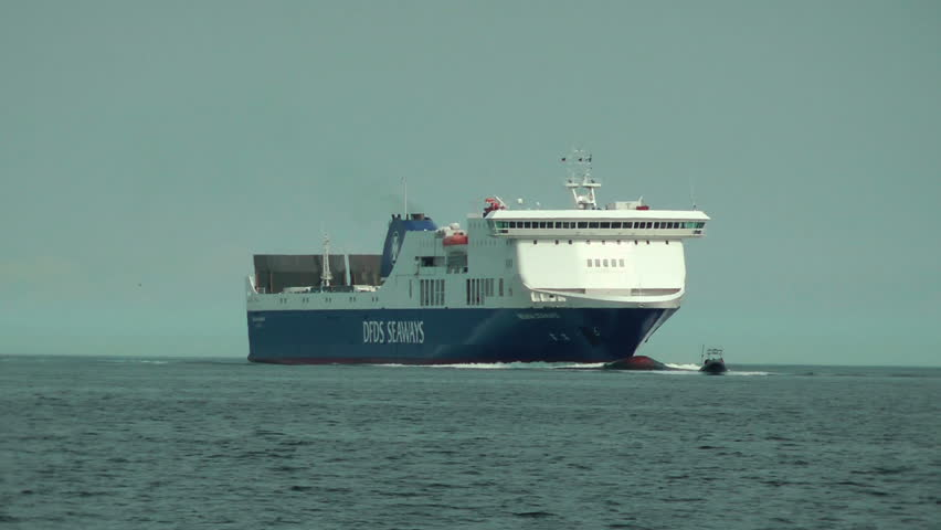 LABOE, GERMANY - APRIL 9: DFDS Regina Seaways being guided by the Pilot on April