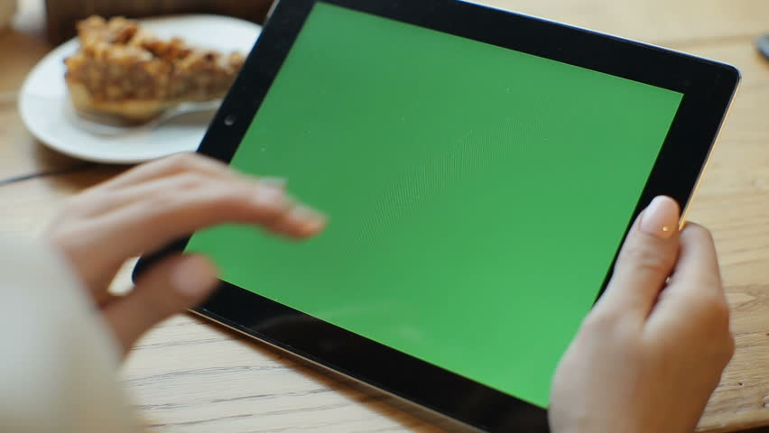 Businesswoman using tablet computer with green touch screen in cafe | Shutterstock HD Video #23824381