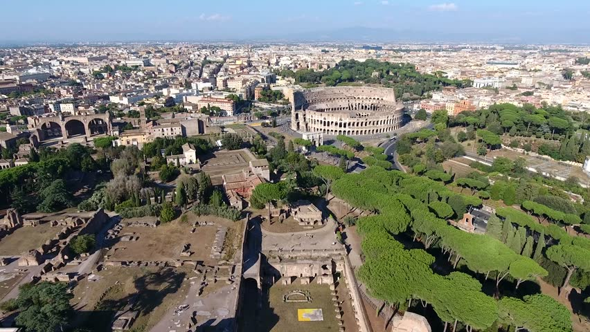 Aerial bird view Italy Rome flying over Domus Severiana moving slowly forwards towards Colosseum extension to imperial palaces Palatine Hill in Roma popular tourist attraction in city center 4k | Shutterstock HD Video #23877436