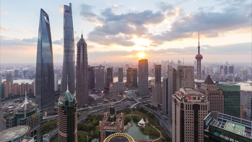 Day to night time lapse of Shanghai skyline and...