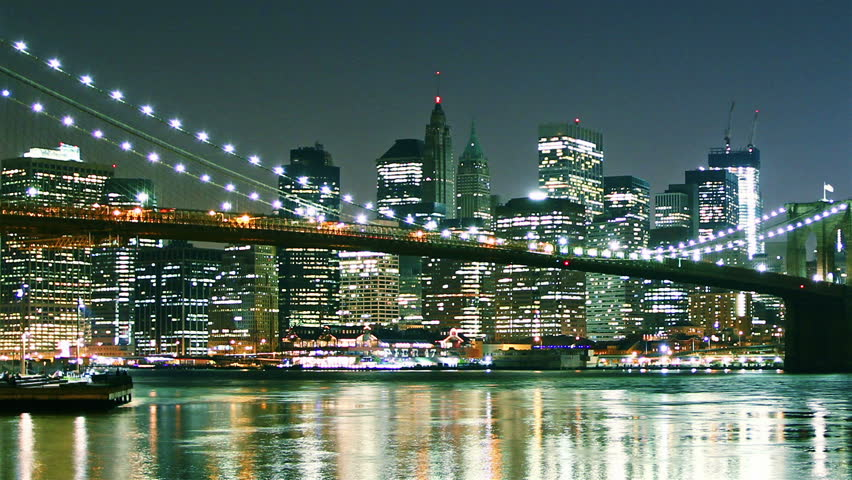 Manhattan skyline and Brooklyn bridge at night. Time lapse and loopable. High quality footage - original size 4k (4096x2304) | Shutterstock HD Video #2424383
