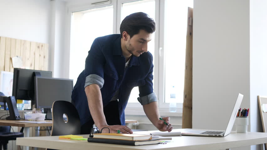 Handsome man, designer working in creative agency office. | Shutterstock HD Video #24287567