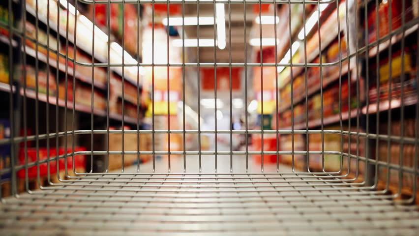 Shopping cart moving through supermarket