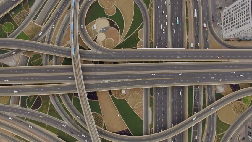 aerial view of road junction with railway tracks...