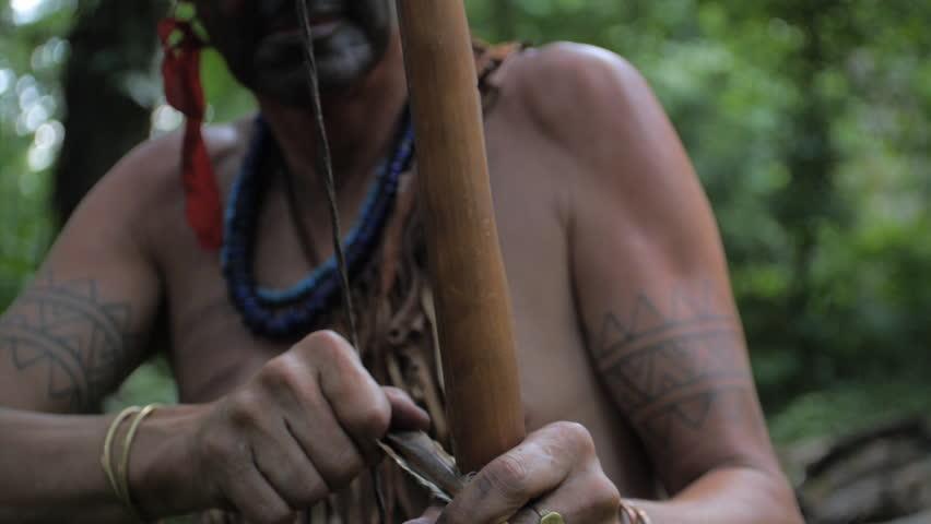 VIRGINIA - SUMMER 2015 - Reenactment, Recreation. Ancient -18th & 19th century, 1500s-1800s Native American, Eastern Woodland Indian Warrior, Powhatan hunting, warpath with bow & arrow.  Flint arrow.