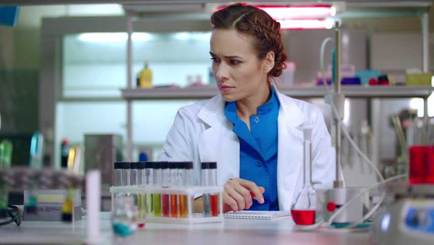Woman Researcher Working In Lab Female Researcher Writing – Lab Chemist
