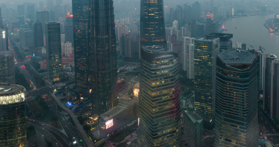 SHANGHAI, CHINA - 18 JAN 2017: Time-lapse of Shanghai's three tallest skyscrapers, the Shanghai World Financial Center, the Jin Mao Tower, and the Shanghai Tower at sunset | Shutterstock HD Video #24523757