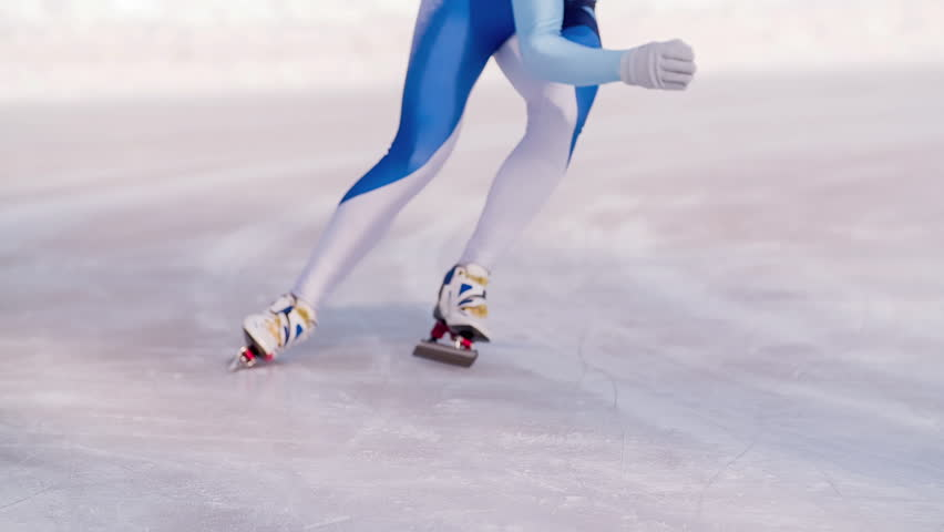 Speed ice skater skating on outdoor race on turn HD slow-motion video. Professional athlete training for winter olympic. View of legs on skates.