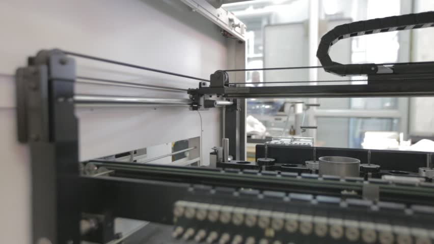 Automated Electronic circuit board production. Machine Produces Printed digital board, contract manufacturing. Manufacture of electronic chips. Camera turns right. High-tech. Industry equipment | Shutterstock HD Video #24624932