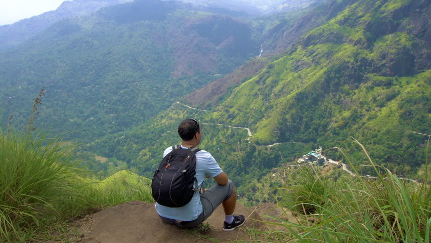 Male Traveler Enjoying the View from Little Adam's Peak
