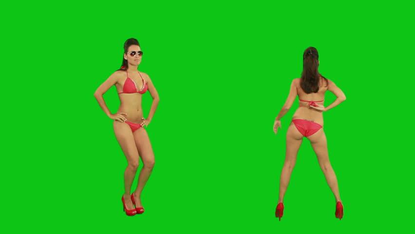 Beautiful young girl dancing against green screen