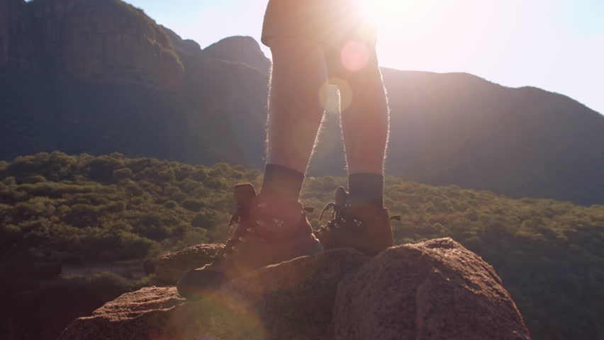 4k of thirsty healthy hiker drinking water from canteen after reaching mountain top at sunset with sun flare. | Shutterstock HD Video #24744485