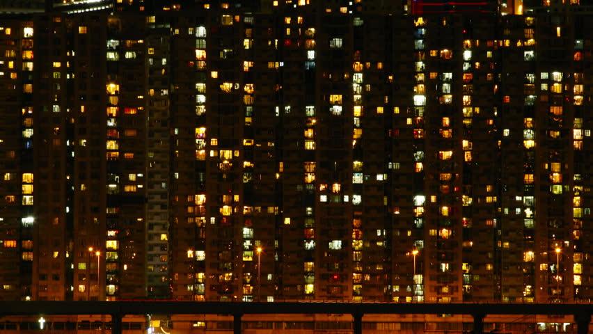 Time lapse of High-density apartment block at night, Hong Kong. | Shutterstock HD Video #2480216