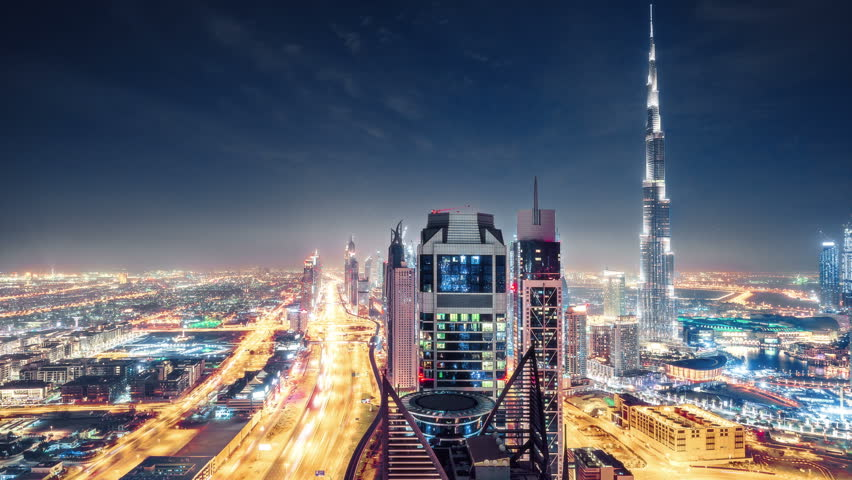 Fantastic nighttime skyline of a big modern city. Scenic aerial view of Dubai downtown skyscrapers and highways with light trails. 4K time lapse. Colouful travel background.  | Shutterstock HD Video #24881936