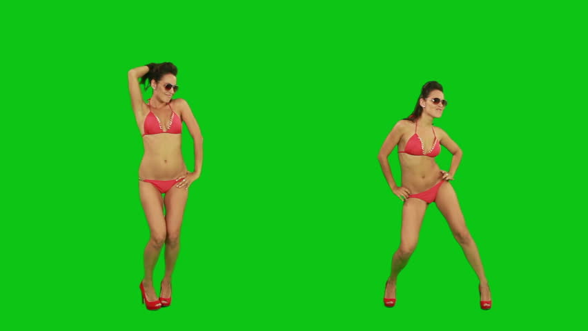 Beautiful young girl in bikini dancing against green screen